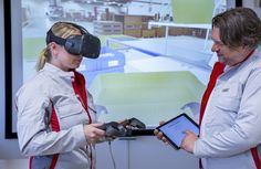 A computer, a pair of virtual reality glasses and two controllers are all it takes for Audi's new interactive learning program for packing logistics.