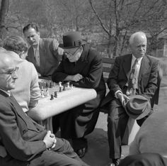 Men gather to play chess in a park on Easter Sunday, April 18, 1953.