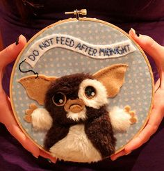 "Boston-based crafter Chelsea Bloxsom created this adorable Gremlins applique piece depicting Gizmo, our favourite Mogwai, along with the most important rule to keep the Gremlins away, ""Do not feed after midnight!"" (Here's a cute progress photo)"