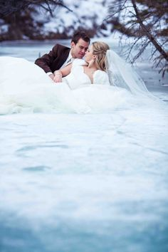winter wedding pictures on a frozen creek.