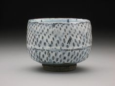 John Neely.. I think this is ceramic and it reminds me of being on the wheel :( I miss it so much!