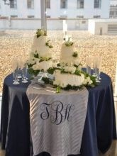 Initials printed on burlap on the cake table!!