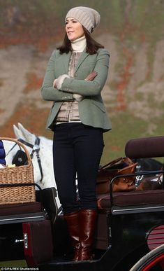 Effortless: The glamorous Princess wore a tailored green blazer, gold puffer vest for the ...