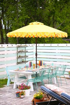 Colorful backyard patio with umbrella and planters