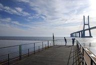 Some jogger looking to the Vasco da Gama Bridge.