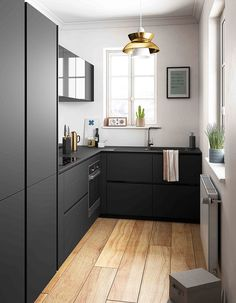 small spaces: matte black cabinetry + timber flooring.