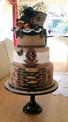 A steampunk themed wedding cake by Julie - http://cakesdecor.com/cakes/292984-a-steampunk-themed-wedding-cake
