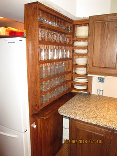 I wanted guests to easily find glasses and plates. These two open-shelf wall cabinets hold a lot of glasses and plates, in just a 16 inch wide space. They were custom built by MIDWEST CLASSIC FURNITURE & CRAFTS. The open shelf cabinet, on the left, is mounted onto a refrigerator cabinet side panel, left over from a kitchen remodel.