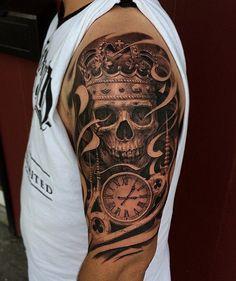 Tatuagens no braço de caveiras