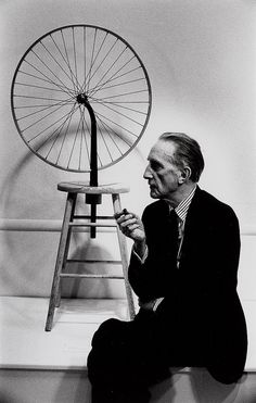 Marcel Duchamp with Bicycle Wheel, a readymade sculpture. Using pre-existing objects and appropriating them resembles later issues we face today with copyright and when something is considered an original.