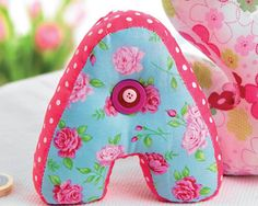 Stuffed Fabric Letters to update a child's bedroom. Free pattern from Sew Magazine online.