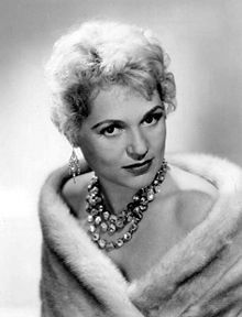 "Judy Holliday (June 21, 1921 – June 7, 1965) was an American actress. Her success in the 1946 stage production of Born Yesterday as ""Billie Dawn"" led to her being cast in the 1950 film version, for which she won the Academy Award for Best Actress.She was noted for her performance on Broadway in the musical Bells Are Ringing, winning a Tony Award for Best Performance by a Leading Actress in a Musical and reprising her role in the 1960 film."