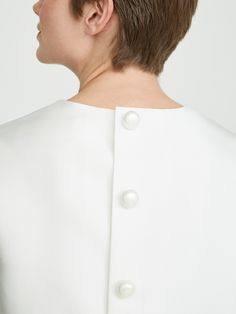 Top with boxy shape in double white duchesse with short sleeves and round neckline. The rear press stud fastening features pearl-effect beads. Silk blend lining. Max Mara Bridal, Chef Jackets, Short Sleeves, Collection, Neckline, Pearl, Shape, Silk, Women