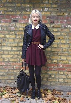 Burgundy dress with a white collar, black leather jacket, brown belt, black tights, shoes and leather bag.