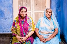 India. Two ladies from Jodhpur wearing colorful saris.
