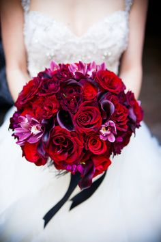 Breathtaking deep red and purple bridal bouquet, photos by Callaway Gable | via junebugweddings.com