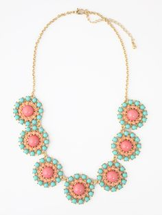 Floral Disposition Necklace It's a fresh as a Spring day with this sweet statement necklace of the prettiest pastels! It's the perfect compliment for an elegant white dress or pairing with a tee on weekends.  Acrylic; Plated base metal  Measures 16 inches long; 3 inch extender  Price: $29.00