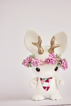 Mijbil Creatures: A pink flower crown..