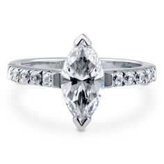 Bold and seductive, the marquise cut solitaire ring exudes feminine beauty with a daring fashion. Made of rhodium plated fine 925 sterling silver. Features 1.62 carat marquise cut cubic zirconia (12mm x 6mm) in 2-prong setting. Accented with 0.3 carat round cut CZ in pave setting. Band measures 2mm in width. Nickel free.