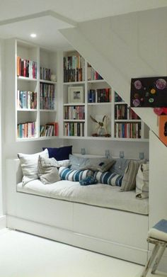 Awesome reading nook built in under the stairs!  Why don't builders always do this?