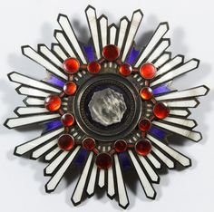 Lot 371: World War II Era Japanese Sterling Silver Breast Badge Medal; First Class Order of the Sacred Treasure; having red, blue and white enamel over metal, four prong back; incised marks en verso, possibly second class