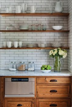 I love the open shelving in this kitchen and the subway tile. The neutral white is classy and beautiful. Seriously gorgeous! You will love all of these kitchens so much. The perfect touch of farmhouse, french country and rustic. #gorgeouskitchen #kitchengoals #whitekitchen #farmhousesink #farmhousekitchensick #farmhousekitchen #neutralkitchen #whitefarmhouse #rustickitchen #rustichomedecor #kitchen #woodandwhitehome #subwaytile