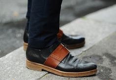 Interesting combo of black and brown leather. (Tommy Ton's Street Style: Paris: Style: GQ)