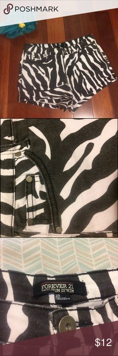 Forever 21 zebra-print denim shorts Size 29. High-waisted denim shorts with faded black & white zebra-print. Great condition, rarely worn. Back pocket detail - see additional pictures. Please ask if you have any questions. Thank you! Forever 21 Shorts Jean Shorts