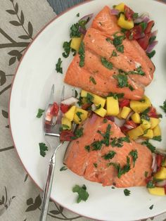 Orange Lime Salmon with Mango Salsa is simple, nutritious and versatile.  You can bake or grill this salmon, eat it aside a salad and side dish or over a bed of greens.  The sweet, fruity flavors pair nicely with the salmon and make it a family favorite and a great dish for lent. // A Cedar Spoon #ad