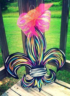 Fleur de Lis painted door hanger with bow.