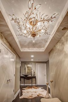 Luxury Chandeliers & Lighting.❤️Love this crystal light fixture, it actually looks like a large medallion because of how it spans the ceiling.❤️