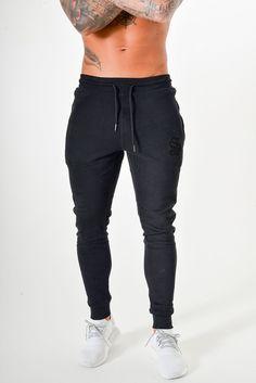 Pantalón jogger Sinners Cintura de goma Cordones en la cintura Bolsillos  delanteros con cremallera Logo bordado f4d9262e1503