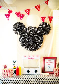 Mickey Mouse ~ Mickey Mouse Birthday Party ~  Wrapping paper  is used as a great source for decor and there are 3 types of wrapping paper in this photo.    There are 26 Mickey crafts, tutorials, and parties over on the Tip Junkie creative community to help you plan your party.