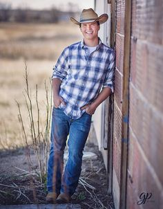 Country guy senior portrait idea.  Good pose for a guy.  Great cowboy smile!
