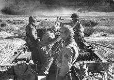 """""""A tank-artillery team stands on alert. This kind of unit -- a 105mm. howitzer mounted on a half-track -- has proved a 'winning combination,' according to Army experts, in ground warfare in Tunisia."""""""
