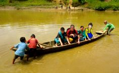 Flat Lottie travels by canoe in South Asia with IMB workers to share the Gospel in villages