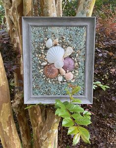 """17""""x 14"""" Beach Glass Wall and/or Window Art/Seashell Art/Resin Art/Unique Coastal Decor/Sun Catcher/Beach House Decor/Great Christmas Gift  Handmade in South Carolina with high quality materials (seashells, crushed glass, crushed shells, sand dollar, sand pebbles) and secured with care. The design Nautical Wall Art, Coastal Wall Art, Coastal Decor, Seashells, Starfish, Crushed Glass, Seashell Art, Sea Glass Art, Window Art"""