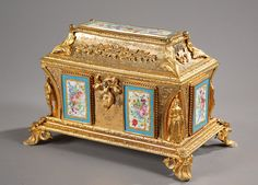 See more images and all info on the link A Nineteenth century gilt and chiseled bronze jewelry box with its key resting on four feet in shell underlined with foliated scrolls. The lid and the body of the box...