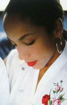 The QUEEN HERSELF, Ms. SADE ADU with PHILLIP X. WHITE....