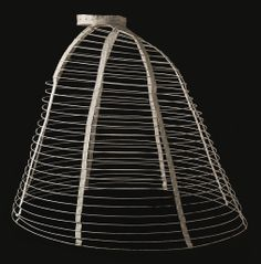 LACMA Womans Cage Crinoline England, circa 1865 [probably more Costumes; underwear (lower body) Cotton-braid-covered steel, cotton twill and plain-weave double-cloth tape, cane, and metal Center back length: 36 in. Diameter: 38 in. Robe Style Empire, Victorian Era, Victorian Fashion, Fashion Vintage, Vintage Underwear, Hoop Skirt, Historical Clothing, Edwardian Clothing, Fashion History