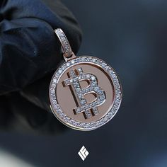 Solid 14K Rose Gold Micro Bitcoin Piece Version 2.0 Partially Iced Out With White Diamonds. Available on www.IFANDCO.com #Bitcoin #Crypto #CustomJewelry #IFANDCO