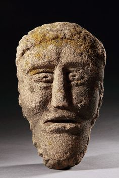 British Celtic Sandstone Head, 100 BCE to 100 CE. The symbol of the severed human head was as important to the Celtic religion as is the cross in Christianity. It was the seat of the soul, symbolised divinity, and possessed all desirable qualities. It could remain alive after the death of the body and convey prophetic information. Celts were head-hunters and heads served as trophies whose powers would protect the fortress or home.