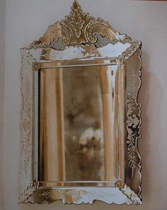 venetian mirror. pretty. pretty. pretty. I want in my entry hall....