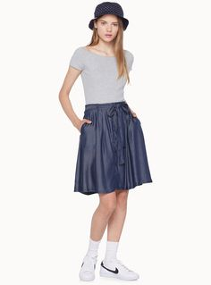 A skirt that slips on easily and can be worn either dressed up or dressed down   Soft, light and fluid rayon   Elastic waist at the back to tie in front    The model is wearing size small