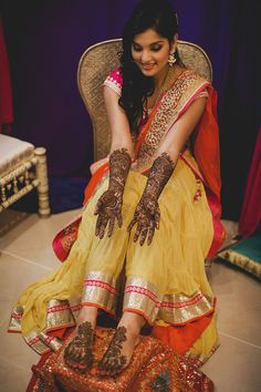 Reshma + Aniket: A Chic Indian Wedding in Sydney and Melbourne - Marathi wedding - henna night - mehendi night - yellow pink and orange Chamee and Palak lehenga #thecrimsonbride