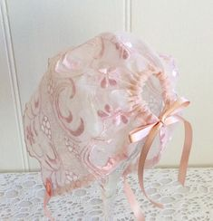 This exquisite Baby Girls Bonnet is made out of a Vintage Embroidered Organza. The piece dates back at least 40years possibly more. Although I have different sizes it is an easyfit style bought in at the back with satin ribbon and tied under the chin, again with satin ribbon. It is