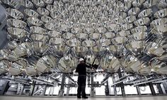 "German scientists flipped the switch on the World's largest artificial Sun.The honeycomb-like structure of 149 spotlights-officially known as ""Synlight""."