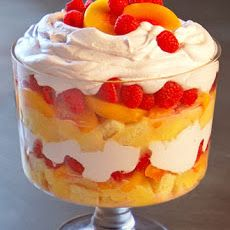 Christmas Trifle - Using store-bought pound cake and lemon curd for this dish is a guaranteed time-saver. This trifle can be prepared in advance and stored in the refrigerator until it's ready to be served (angel food cake trifle dishes) Trifle Dish, Trifle Desserts, Trifle Recipe, Just Desserts, Delicious Desserts, Dessert Recipes, Yummy Food, Fruit Trifle, Fruit Dessert