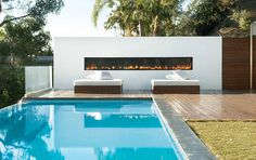 Outdoor fireplace by the pool.