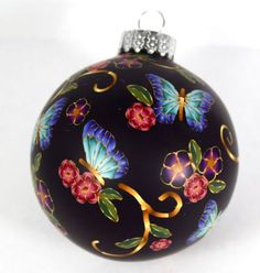 FREE TUTORIAL: Beautiful polymer clay butterfly ornament from Polymer Clay Workshop. Includes a link to a video tutorial on reducing and applying backgroundless canes.